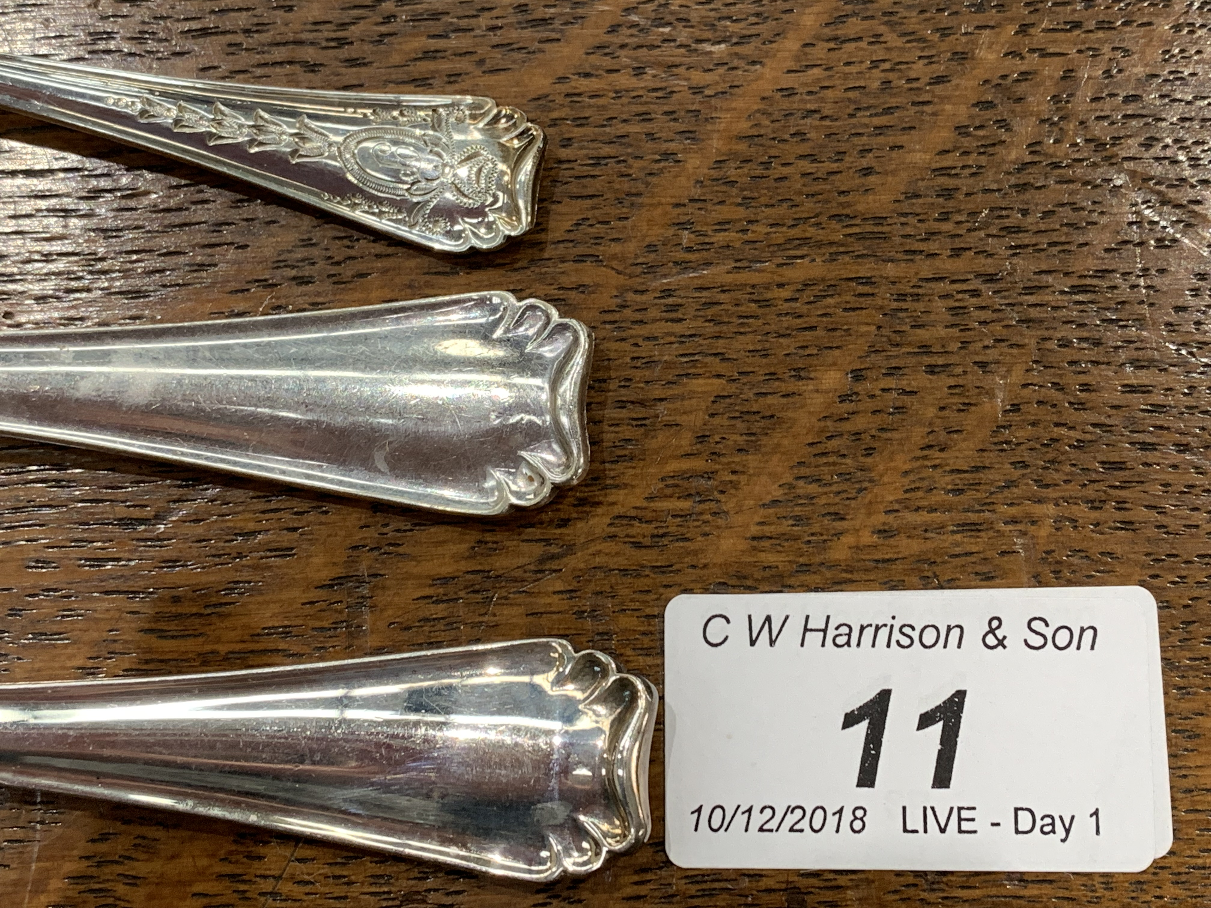 Lot 11 - A suite of plated table cutlery, twelve place settings (some items lacking),
