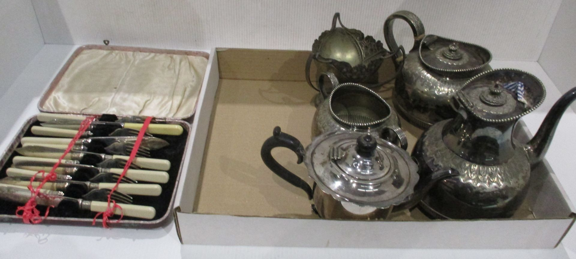 Lot 23 - A fish knife and fork set and five other plated items - teapots,