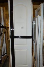 Lot 32 - *Wood Crate Containing Twenty Paneled Door with Su
