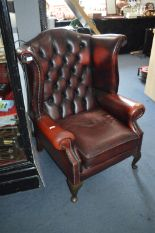 Lot 814 - Oxblood Leather High Wingback Buttoned Armchair