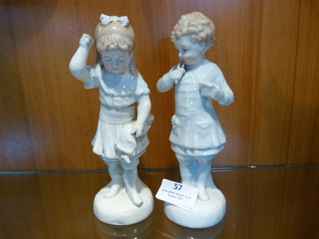 Lot 57 - Pair of Early 20th Century Pottery Figurines - Boy
