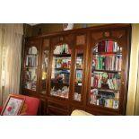 Libreria tre ante in vetro, quattro ante in legno e quattro cassetti, cm. 270x45xh240, anni'70