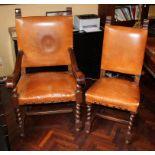 Lotto di una poltrona e due sedie rivestite in cuoio, primi '900