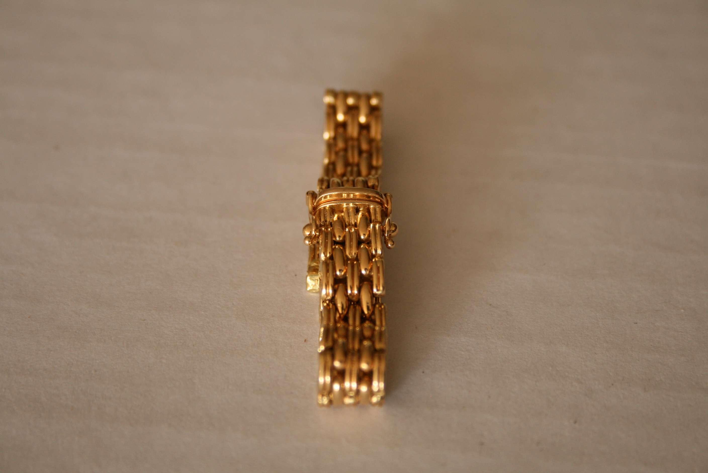 Lot 12 - Bracelet de montre en or 750/18ct - Poids : 26,7 g - 750 / 18ct gold watch strap - [...]