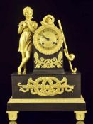 A GILT AND PATINATED BRONZE FIGURAL CLOCK, EMPIRE / RESTORATION PERIOD, FRANCE 1820-1825Origin: