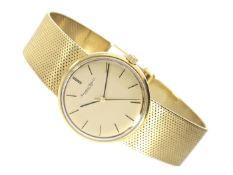 Armbanduhr: goldene Herrenuhr von IWC, ca. 1973 Ca. 34mm, ca. 84g, ca. 20cm lang, 18K Gold,