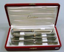 Cartier, 5 Buttermesser Stahl, Cartier signiert, vergoldet. In originaler Box. Leichte