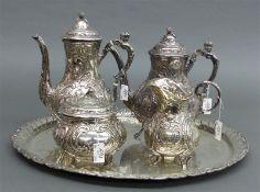 Silberservice 5-tlg., zwei Kannen, Zuckerdose, Milchkännchen, Tablett, reicher Reliefdekor, Putti