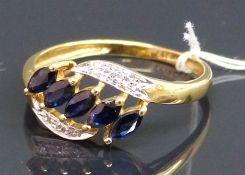 Damenring 14 kt. Gelbgold, 5 Saphir-Navetten, 4. kl. Diamanten als Besatz, durchbrochen