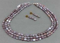 SchmuckgarniturSilbermonturen, Achattropfen, 1 Collier 3-reihig, 1 Paar Ohrhänger, l 48 cm,