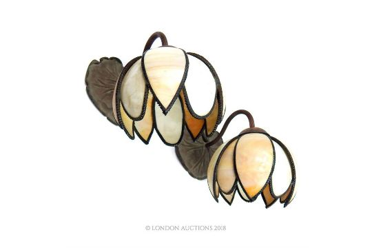 a pair of art nouveau style wall lights purchased from christopher