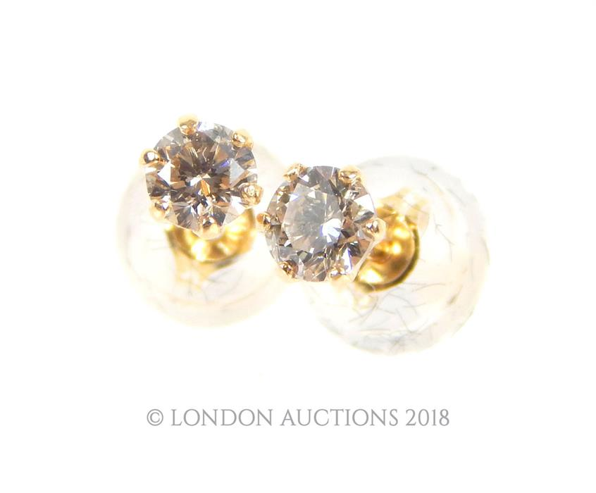 Lot 31 - A boxed pair of 18 ct yellow gold, diamond stud earrings (Total 0.20 carats)