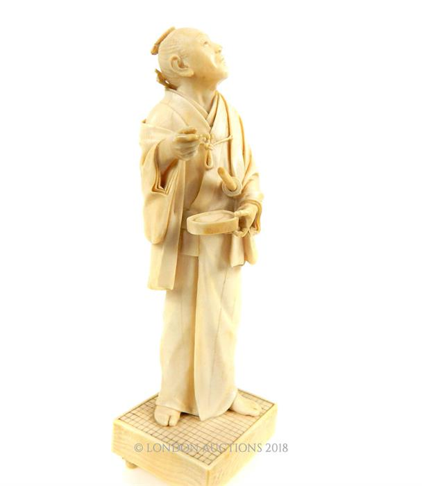 Lot 29 - A 19th century Japanese carved ivory okimono