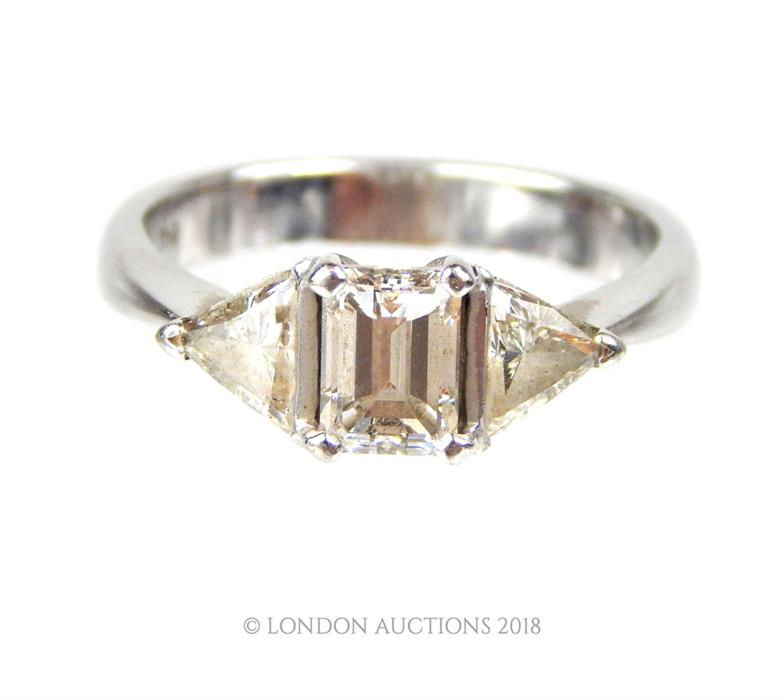 Lot 5 - An 18 ct white gold and three-stone, diamond ring