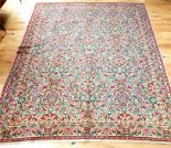Lot 54 - A large, colourful, Persian, woollen carpet