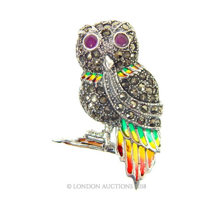 Lot 26 - A silver, plique a jour, owl brooch with ruby eyes