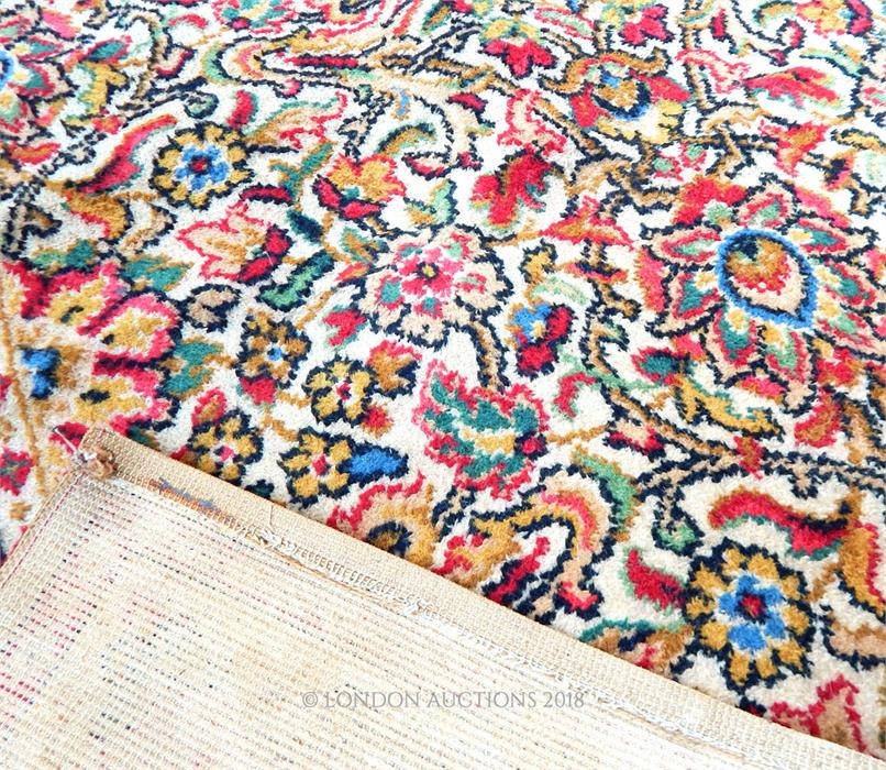 Lot 54 - A large, colourful, Persian, woollen carpet