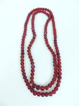Lot 56 - Two red glass beaded necklaces