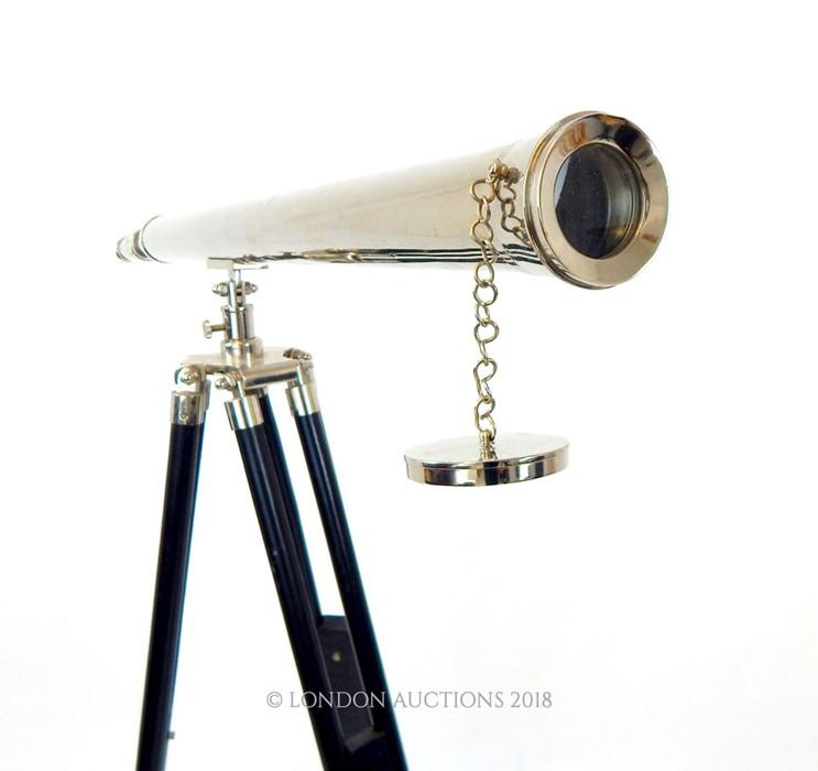 Lot 42 - A contemporary chromed telescope on tripod