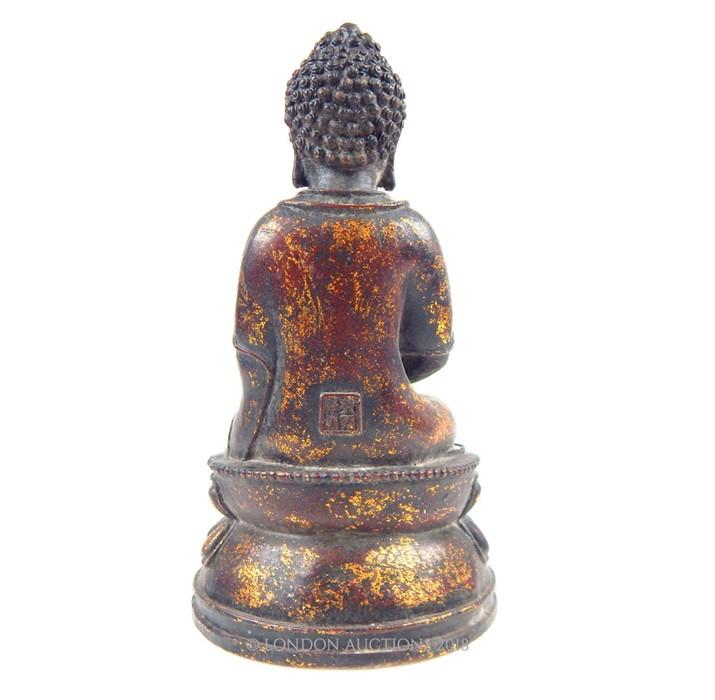 Lot 9 - A Tibetan bronzed metal seated Buddha