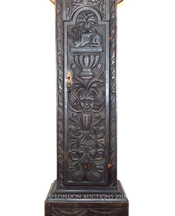 Lot 13 - A Georgian carved oak longcase clock