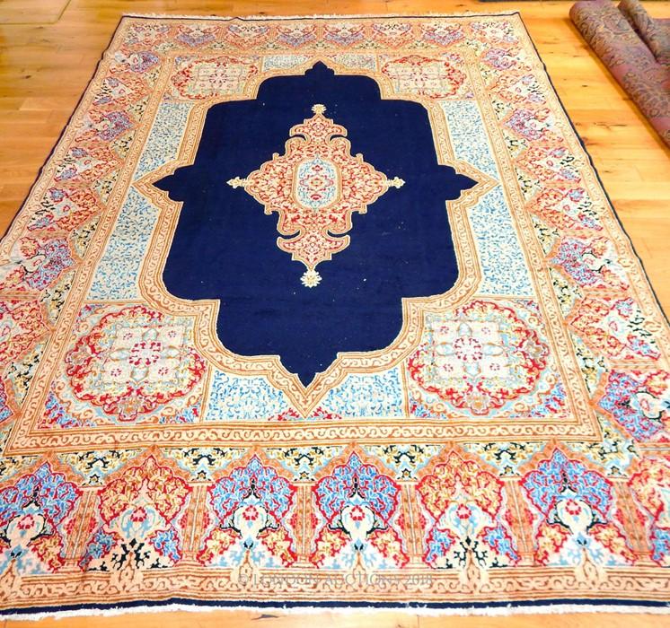 Lot 24 - A large Persian Kerman carpet