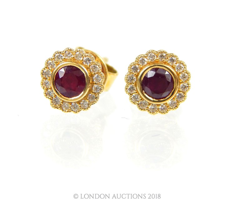Lot 55 - A Pair of 18 carat Rose Gold Diamond and Ruby Earrings.
