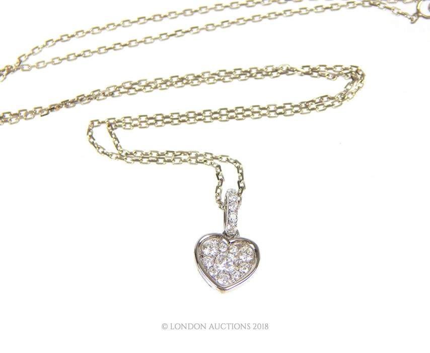 Lot 37 - An 18 Carat White Gold and Diamond Set Pendant Necklace on a gold chain.