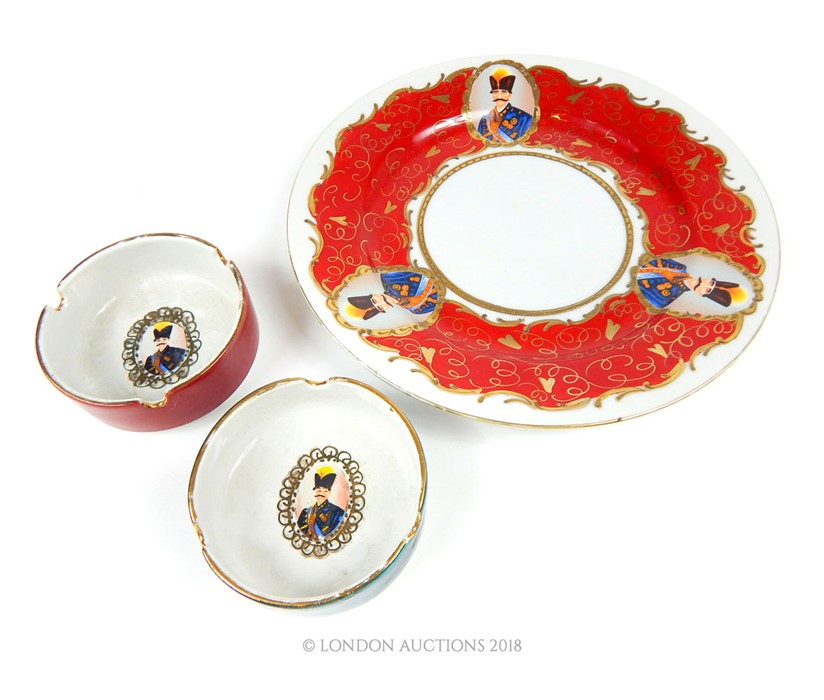 Lot 34 - A Persian plate bearing portraits of Nasirudin Shah of Iran and two ashtrays