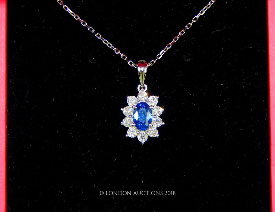 Lot 14 - An 18 Carat White Gold Sapphire and Diamond Pendant Necklace on gold chain