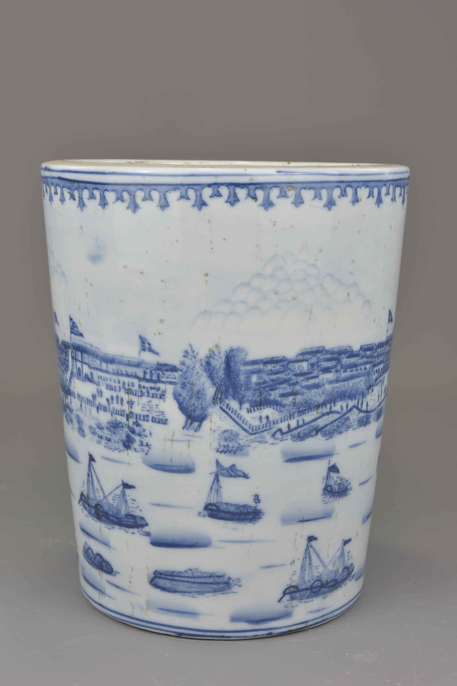 Lot 14 - A Chinese Republican period blue and white porcelain brush pot depicting the '13 Factories of Canton