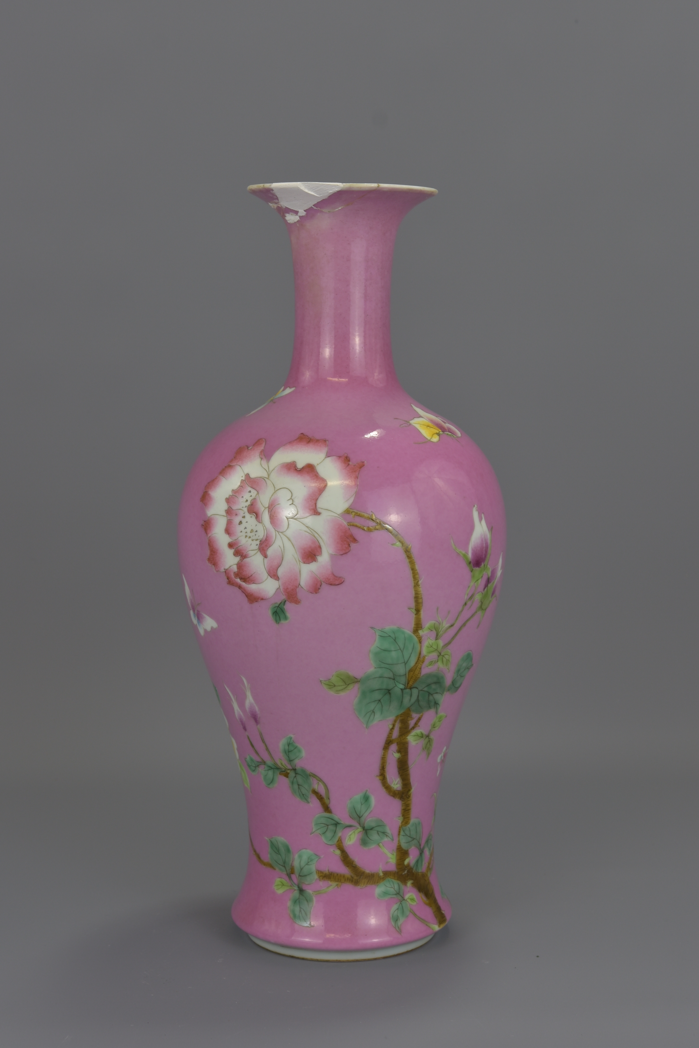 Lot 24 - A Chinese 18th century ruby-pink enamelled porcelain vase decorated with flowers and butterflies. Un