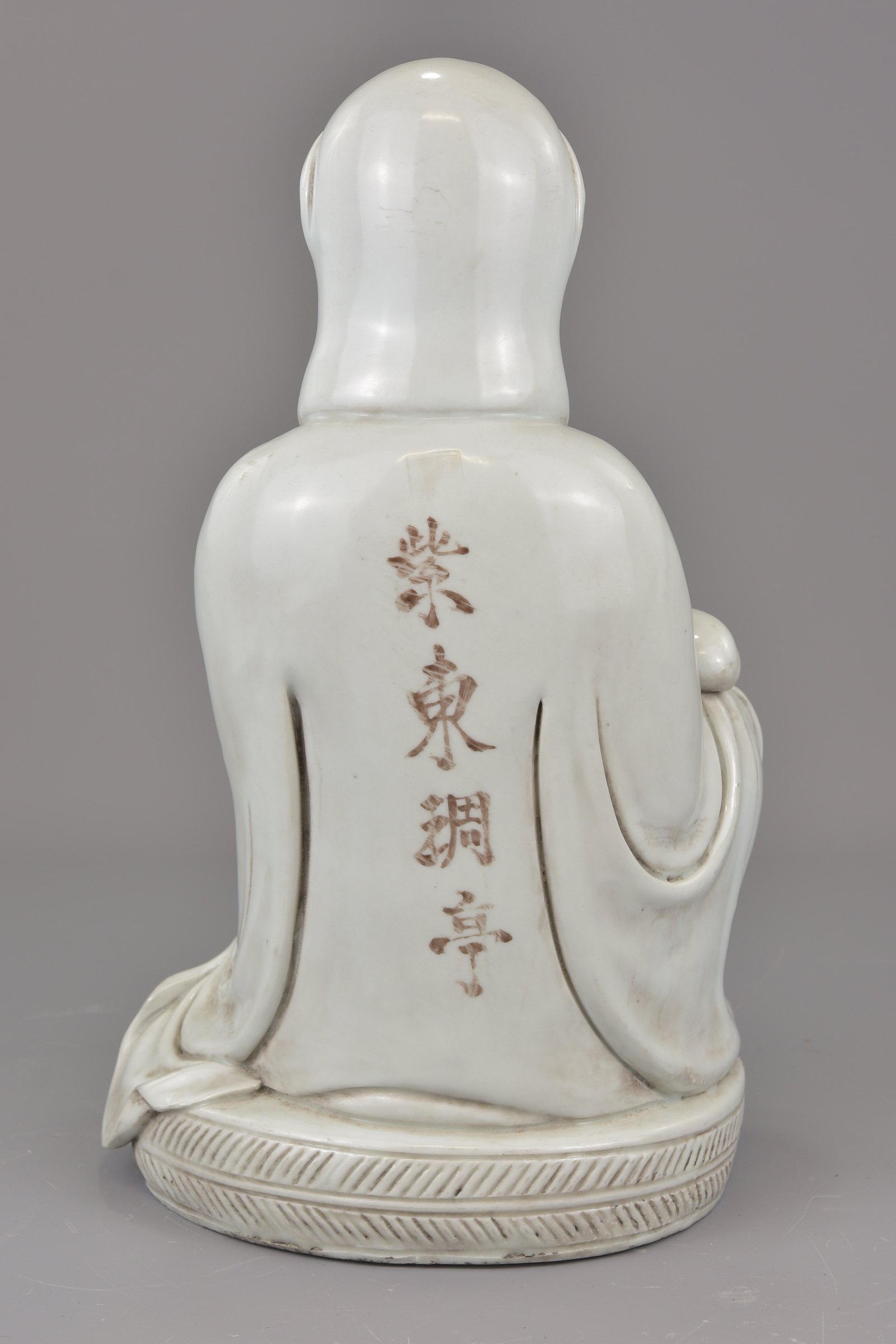 Lot 12 - A Chinese 19th century Blanc de Chine porcelain figure of a Guanyin with four character temple name