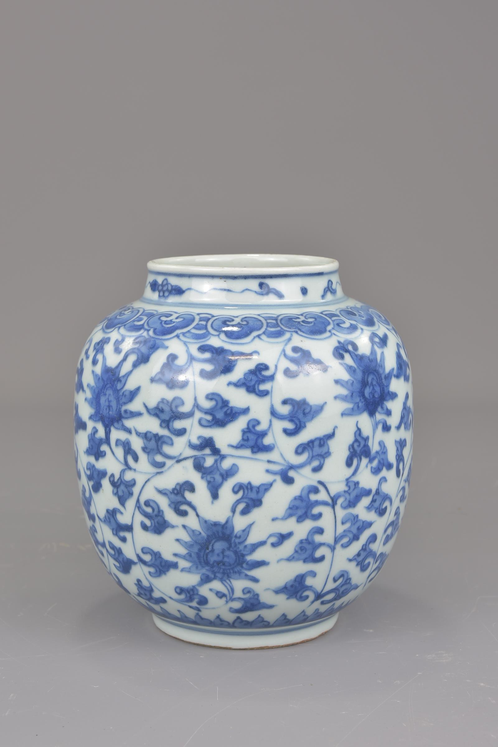 Lot 22 - A Chinese blue and white porcelain jar possibly Ming painted with a floral design. 16cm tall