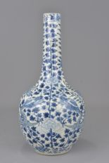 Lot 58 - A Chinese 19th century blue and white porcelain bottle vase decorated with dragon with four characte