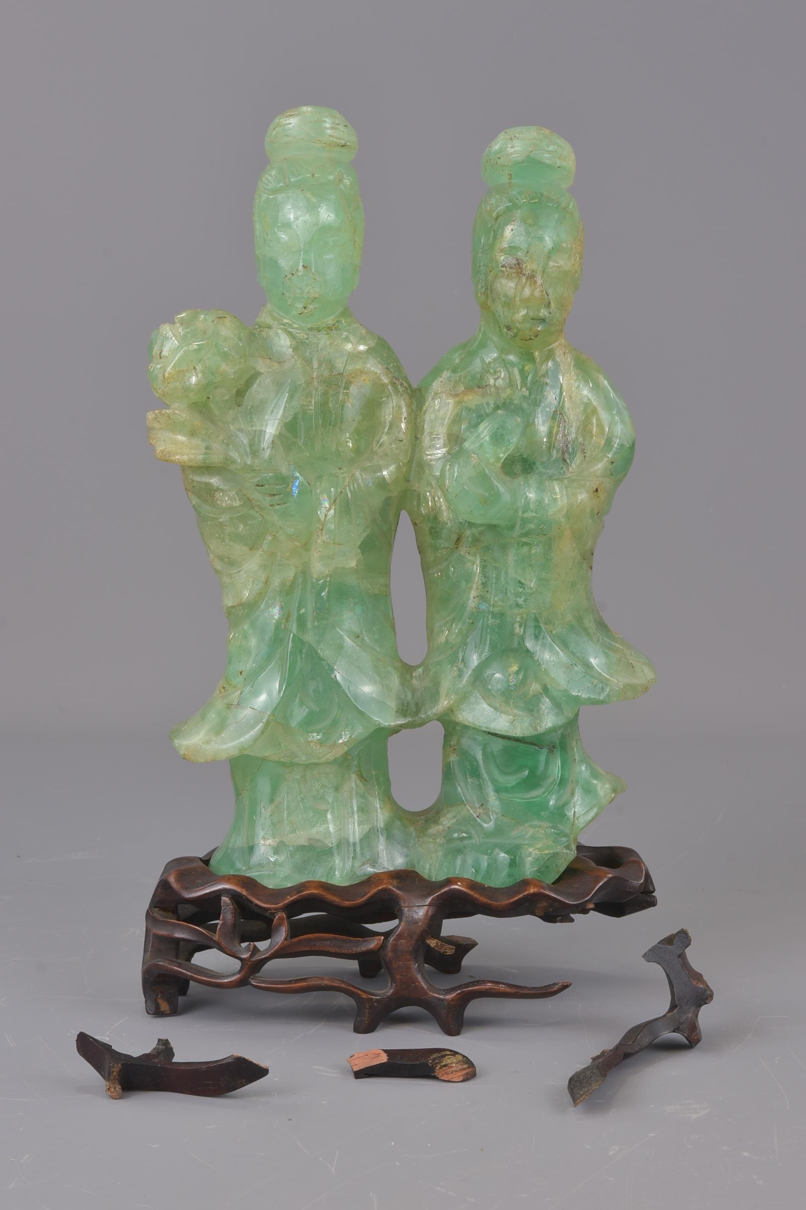 Lot 45 - A Chinese green glass censer and cover together with green stone carving of Guanyin figures on a woo
