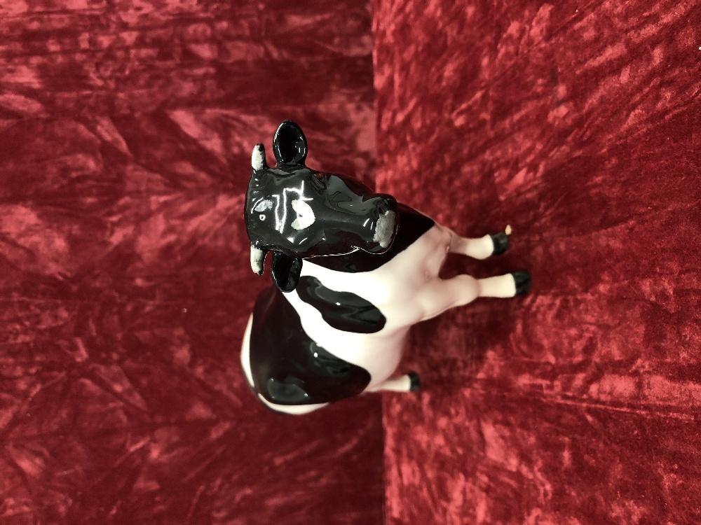 Lot 7 - A Beswick Friesian bull, cow and calf.