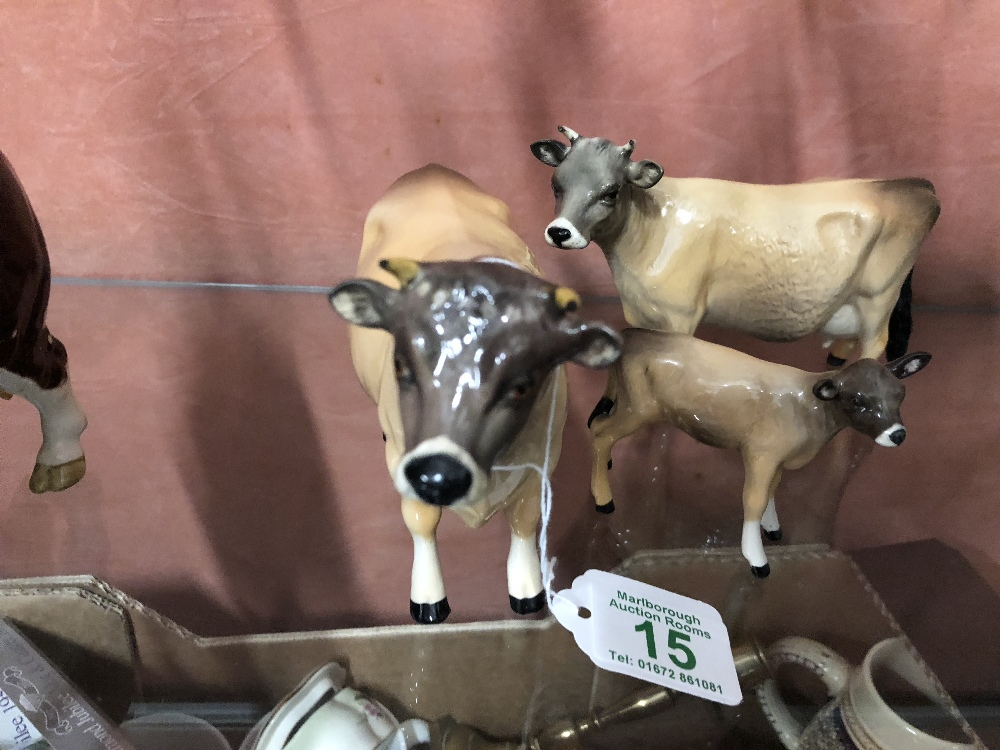 Lot 15 - A Beswick Jersey bull, cow and calf.