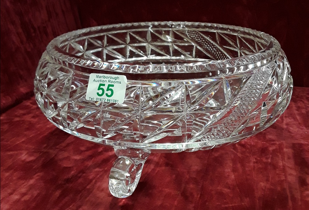 Lot 55 - A large gut glass bowl raised on three supports.