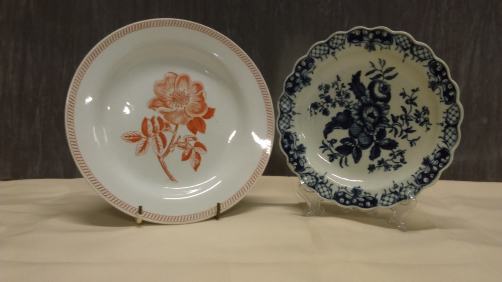 Lot 42 - An 18th Century Worcester blue and white plate and a Wedgwood creamware transfer botanical plate.