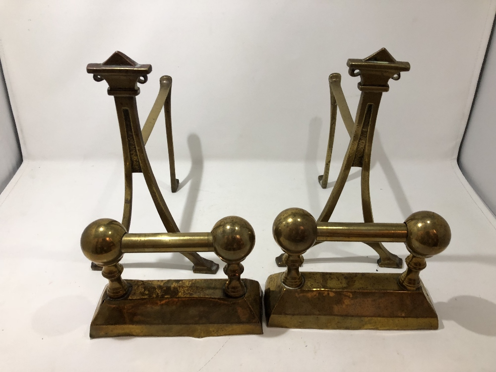 Lot 13 - Two pairs of brass fire dogs including Art Deco.