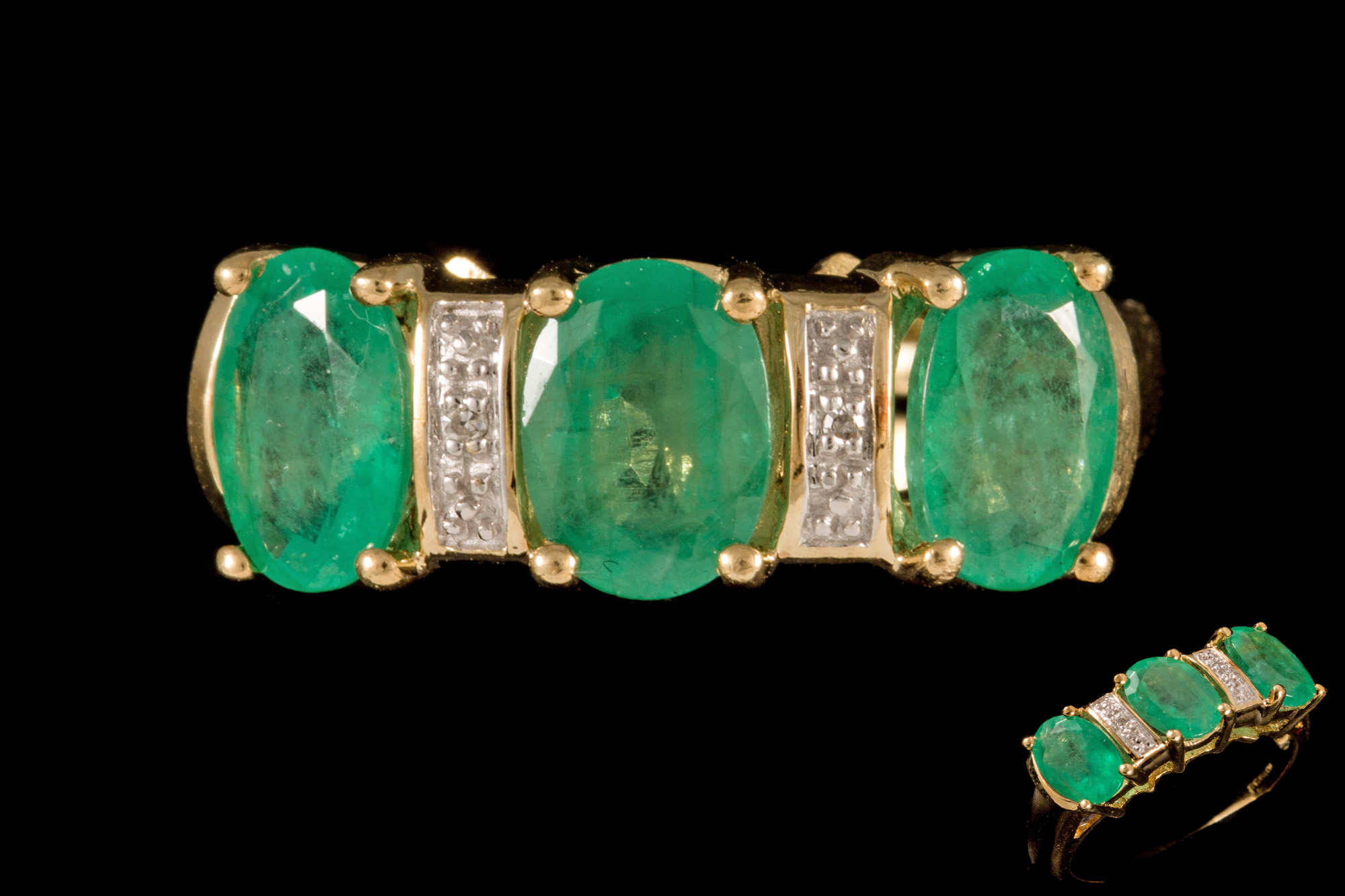 Lot 43 - A THREE STONE EMERALD RING, set with diamond points,
