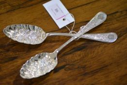 A pair of Edwardian silver berry spoons, Walker & Hall, Sheffield 1901, of characteristic form,