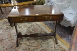 A Regency style satinwood crossbanded burr walnut sofa table, with shaped twin leaves, two frieze