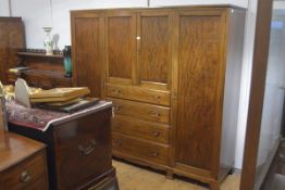 A Whytock & Reid, Edinburgh, 1930's mahogany wardrobe, with a pair of panelled doors over four