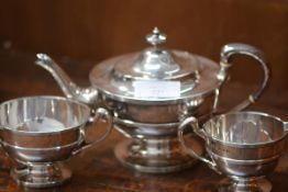 A George V Scottish silver three piece tea service, T.S. Cuthbert, Glasgow 1930, each piece of broad