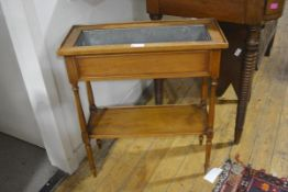 A Continental fruitwood trough jardiniere, c. 1900, raised on slender baluster turned legs joined by