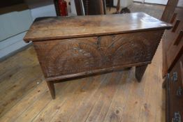 A small oak six plank coffer in 16th century style, the cover with chip-carved ends, the front panel