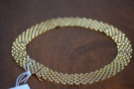 An 18ct gold necklace of shaped plaited links, hallmarked. Length 42cm, 74 grams