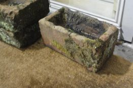 A rectangular weathered red sandstone trough. 22cm by 46cm by 26cm
